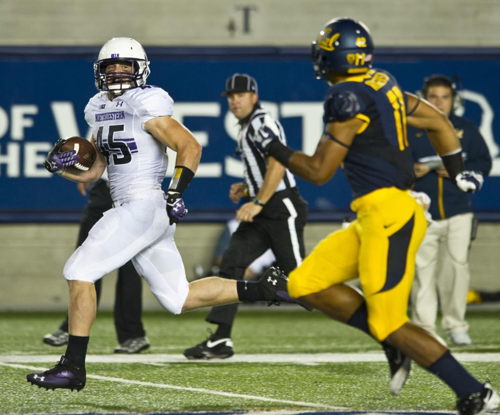 Linebacker Collin Ellis returns one of his two interceptions against Cal. Ellis' two touchdowns helped Northwestern's defense fend off the Golden Bears on Saturday.