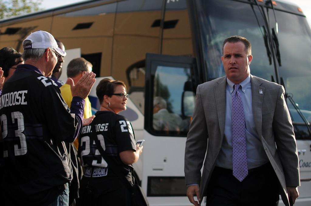 Northwestern coach Pat Fitzgerald walks off the team bus. Fitzgerald picked up his 53rd career win Saturday against Western Michigan.