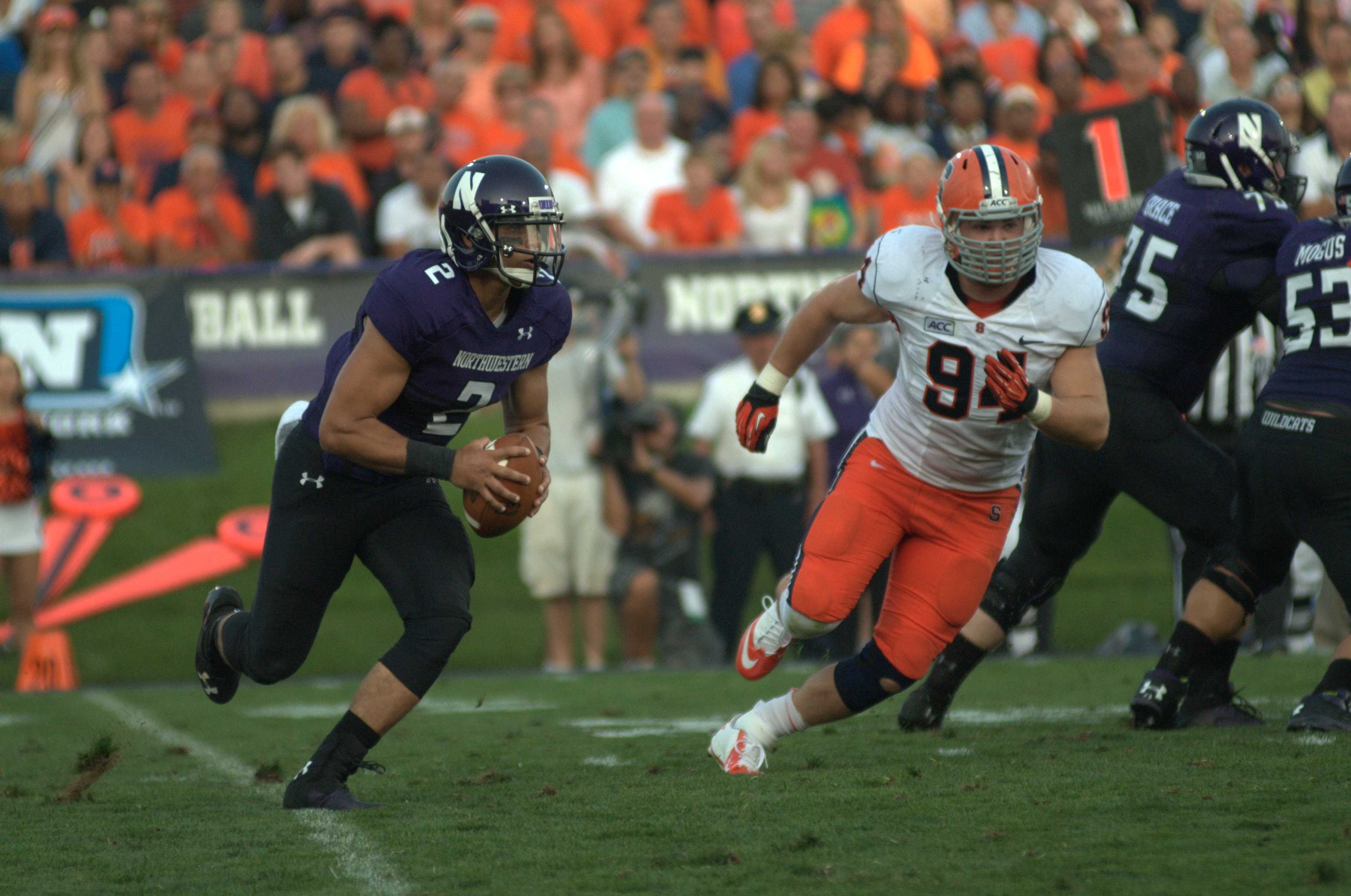 Senior quarterback Kain Colter looks to run the ball against Syracuse. Colter finished the game with 87 yards running and 116 yards passing.