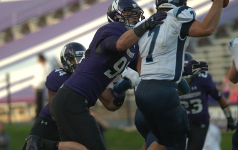 Dean Lowry gets a grip on Maine quarterback Marcus Wasilewski. The sophomore has had a very impressive campaign, nabbing one of Northwestern's pick-sixes in Saturday's game against the Black Bears. NU's coaching staff named him the Defensive Player of the Game for two consecutive weeks.