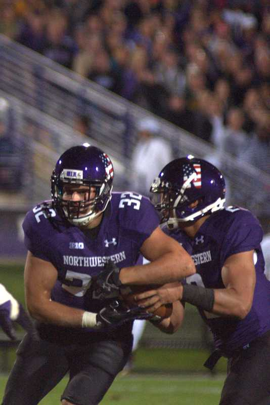 Mike Trumpy fakes a rush against Western Michigan last Saturday. The senior running back was happy to return to a regular practice schedule before FCS foe Maine comes to Evanston Saturday at 2:30 p.m.