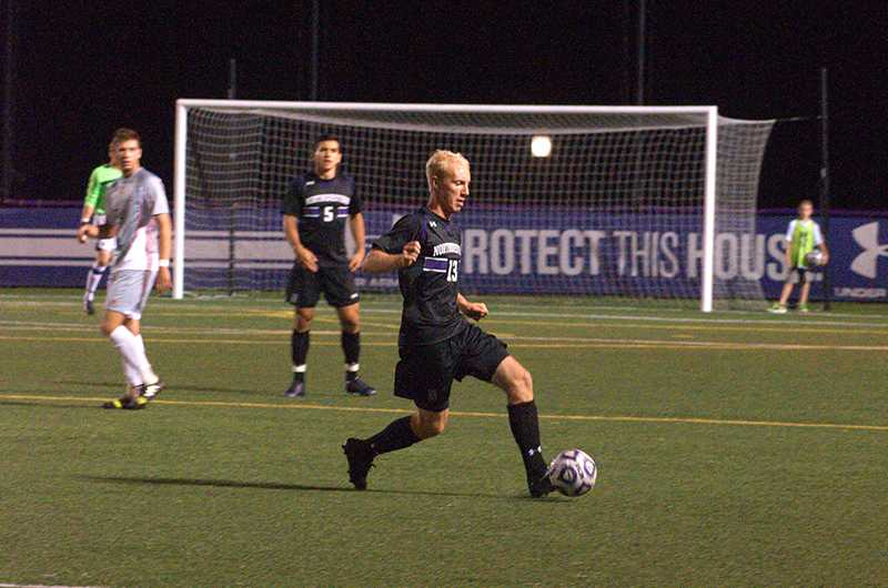 Senior defender Connor Holloway handles the ball at Friday's home game against Saint Mary's. The victory marked the fifth consecutive match in which Northwestern kept its opponent scoreless.