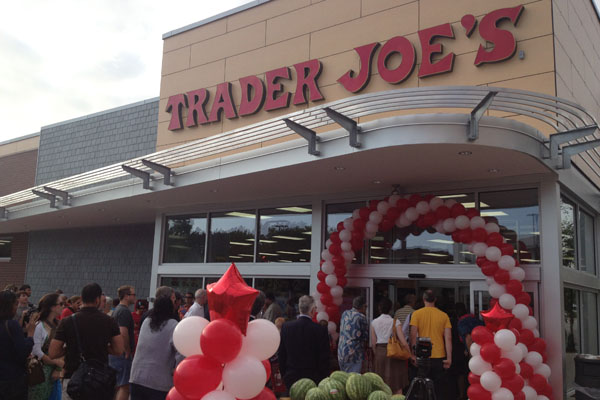 Dozens of customers stream into Trader Joe's on Friday morning. The grocery store, 1211 Chicago Ave., marked its grand opening with a lei-cutting ceremony.