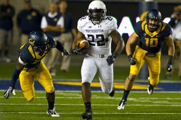 Junior running back Treyvon Green carries the ball Saturday night against Cal. Green led Northwestern in rushing and scored two touchdowns in the Cats 44-30 victory.
