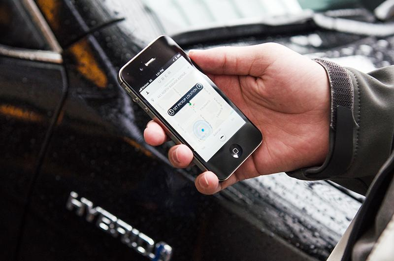 Uber+allows+customers+to+request+a+ride+using+an+iPhone+app.+The+on-demand+car+service+launches+Wednesday+in+Evanston.