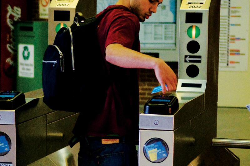 A commuter uses the new Ventra system at the Davis Street CTA station. Ventra allows users to tap their cards for entry rather than swiping them and can be managed online.