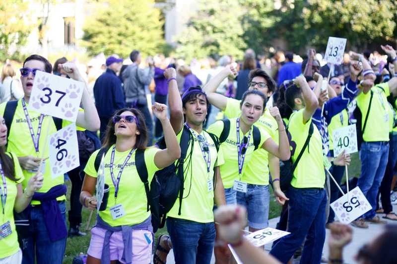 Peer advisers cheer as the class of 2017 enters Deering Meadow during Welcome Week. New programming changes will extend the first year experience beyond new student orientation.