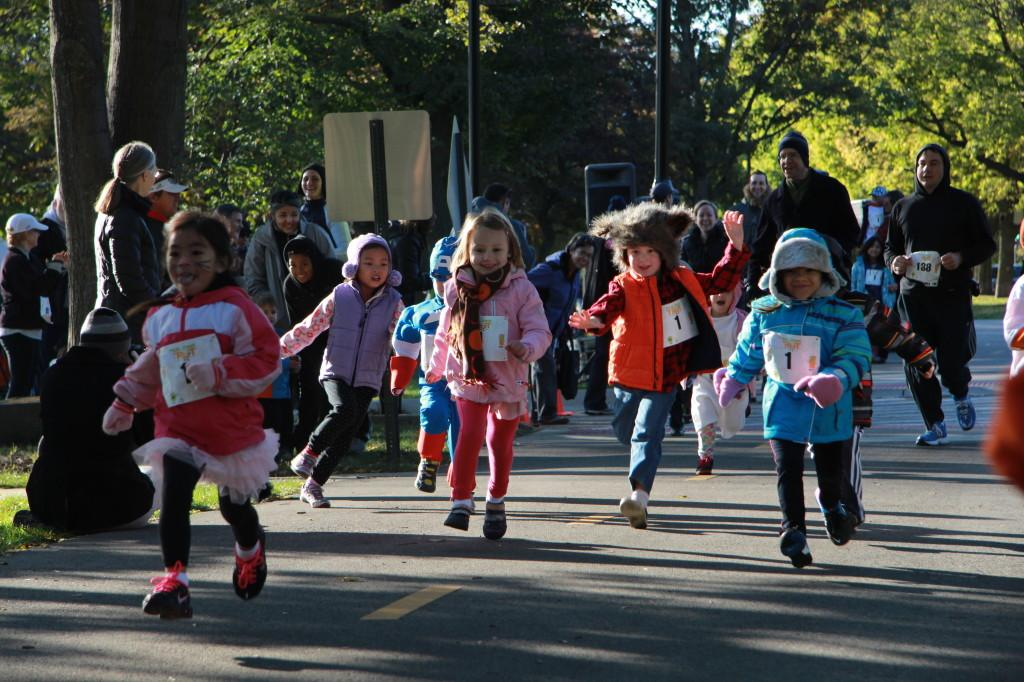 Children run the course of the Trick or Treat Trot on Sunday. They were also encouraged to dress up in Halloween costumes.