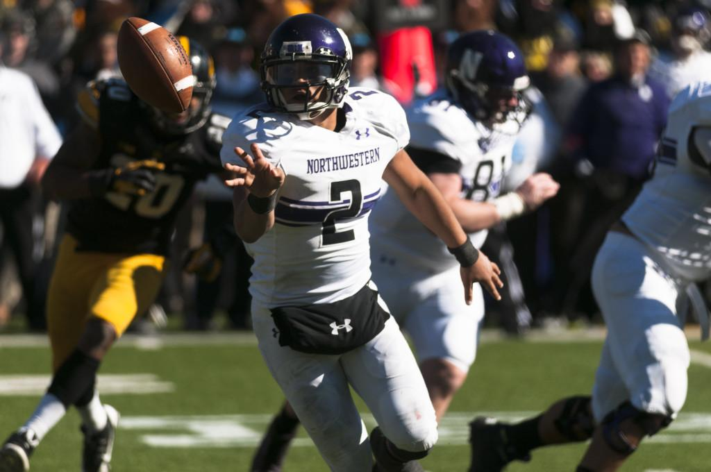 Senior quarterback Kain Colter pitches the ball on an option play. Colter threw for 104 yards and ran for 60 more in Northwestern's 17-10 loss to Iowa on Saturday.