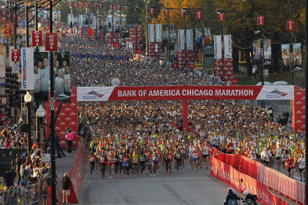 Runners cross the starting line at the Chicago Marathon. This year's run will be held on October 13.