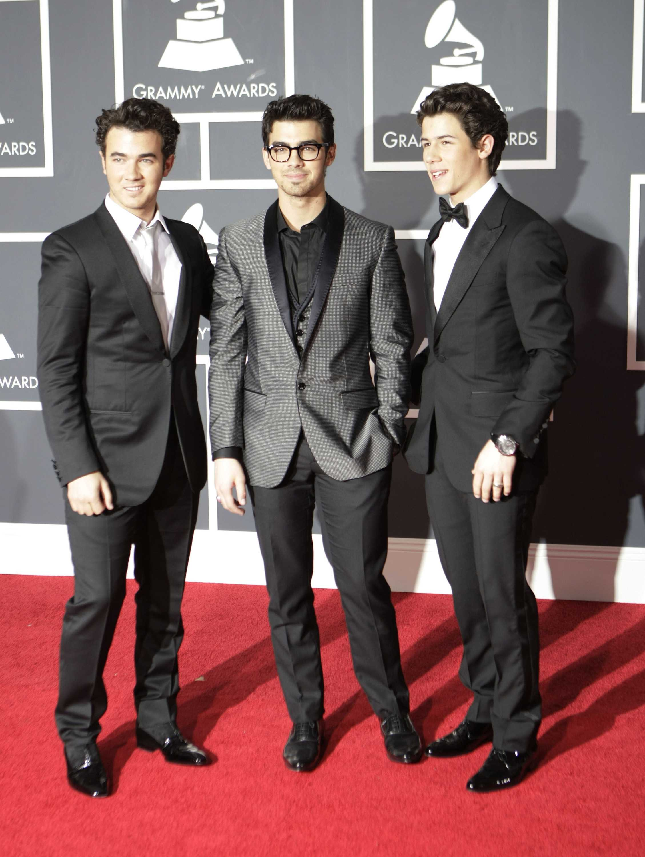 The Jonas Brothers are all smiles in this picture, but rumor has it things have gone downhill. The brothers just announced their world tour will be cancelled.
