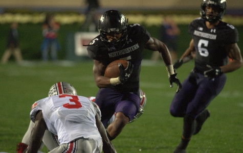 Venric Mark carries the ball against Ohio State. Northwestern announced Monday the senior running back is out for the season with an ankle fracture.