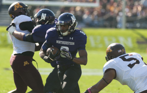 Redshirt freshman Stephen Buckley finds a hole in the Minnesota defense at Ryan Field. The running back accrued 58 yards for the Wildcats, their best performer on the ground. He scored his first career touchdown Saturday.