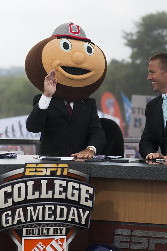 +ESPN+analyst+Lee+Corso+predicts+Ohio+State+as+tonight%27s+victor+by+donning+the+head+of+Brutus+Buckeye.+The+call+garnered+loud+boos+from+the+NU+crowd.