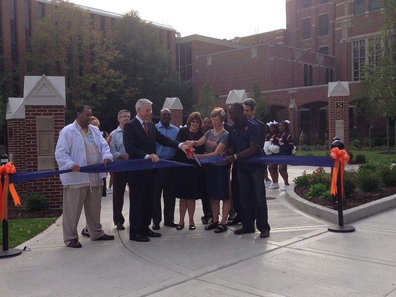Evanston+officials%2C+including+Mayor+Elizabeth+Tisdahl+%28center%29%2C+held+a+ribbon-cutting+ceremony+Friday+afternoon+for+the+new+front+entrance+of+Evanston+Township+High+School%2C+1600+Dodge+Ave.+Tisdahl+called+ETHS+the+%22glue+that+holds+our+community+together.%22%0D%0A