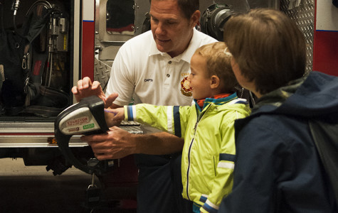 Capt. Paul Polep of Evanston Fire and Life Safety Services demonstrates a thermal imaging camera to local residents. The presentation was part of fire prevention week.