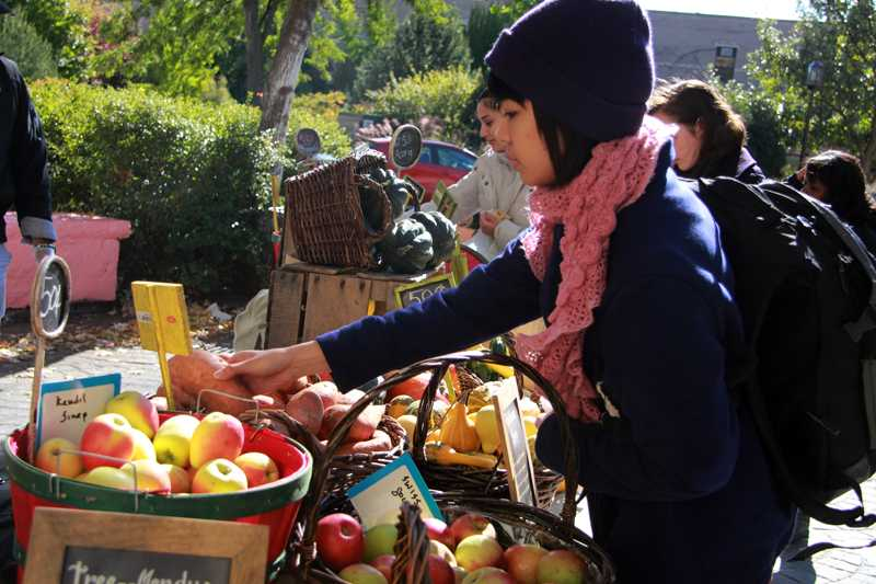 Students select fresh produce at the farmers market held at The Rock on Wednesday. The farmers market was brought to Northwestern by Midwest Foods.