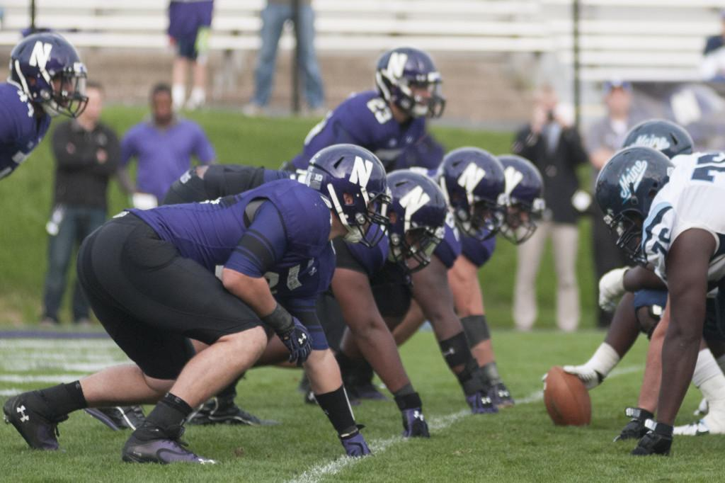 The+Northwestern+defensive+line+digs+in+during+the+team%E2%80%99s+game+against+Maine.+The+Wildcats%E2%80%99+line+will+be+key+in+slowing+down+Wisconsin%E2%80%99s+rushing+attack+Saturday.