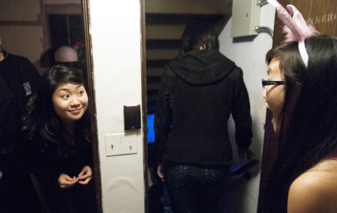 McCormick junior Christina Hua welcomes visitors to a haunted house held in Seabury Hall on Wednesday night. The event was organized by Plex and Seabury community assistants.
