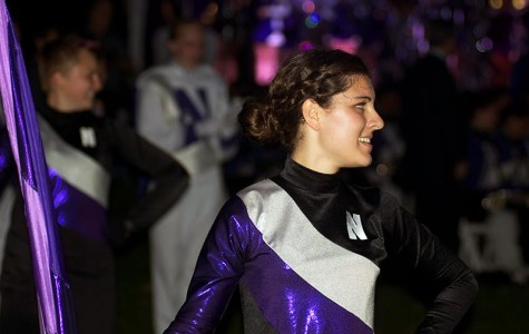Weinberg sophomore Michelle Lortie, a member of the Northwestern University Marching Band's color guard, performs during the Homecoming pep rally Friday evening. University President Morton Schapiro, football Coach Pat Fitzgerald and Homecoming grand marshal Mike Greenberg (Medill '89) pumped up fans during the pep rally.