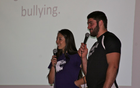 Senior softball player Marisa Bast and sophomore football player Max Chapman speak with students at Haven Middle School. Bast and Chapman are two of 25 student athletes participating in ROARR, a community outreach program intended to raise awareness about bullying.