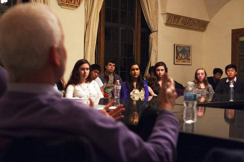 Attendees listen to President Morton Schapiro at the Political Union discussion in Scott Hall's Ripton Room on Wednesday evening. Schapiro described several empirical studies on the economics of higher education in his talk.