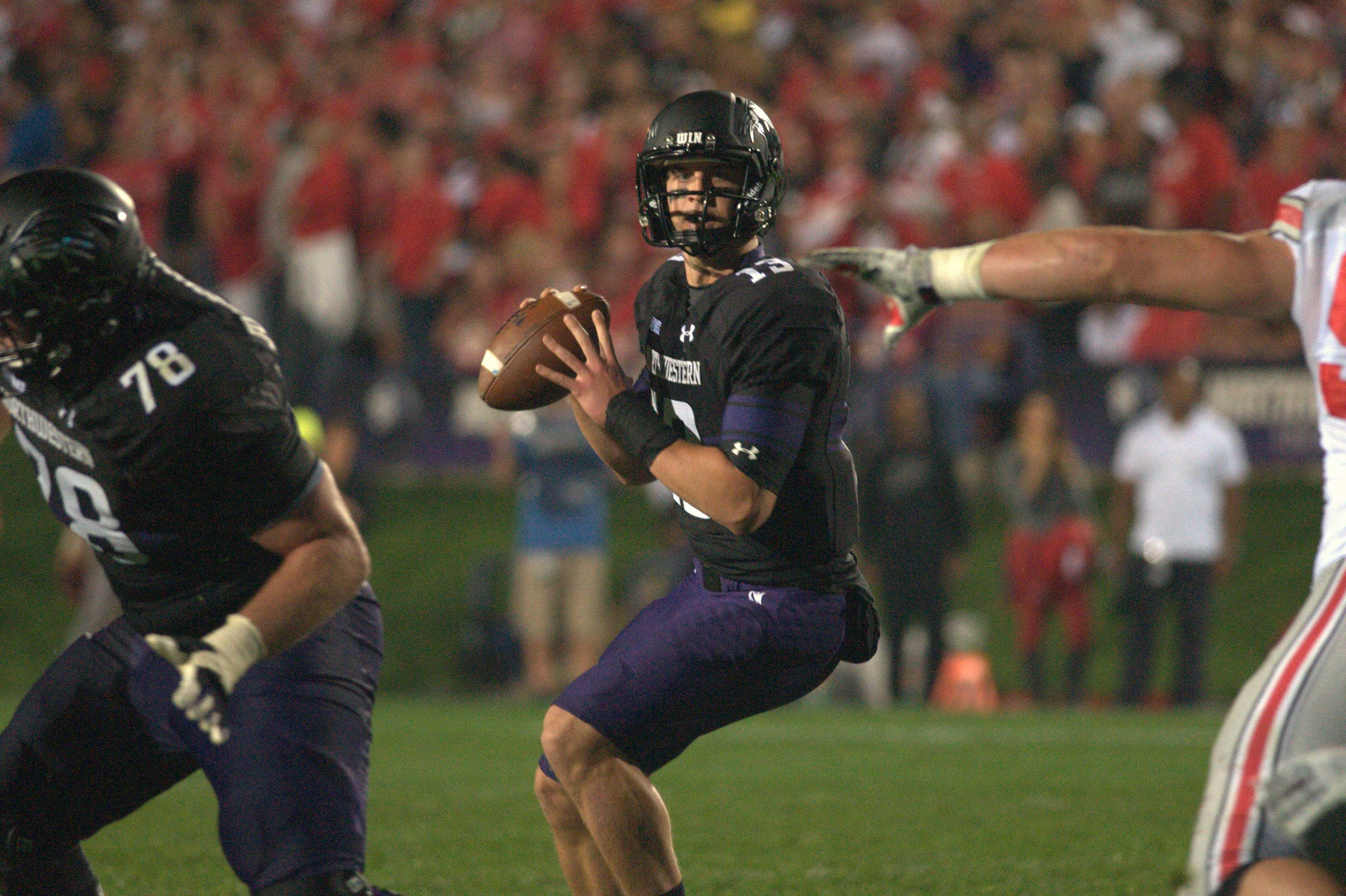 Junior quarterback Trevor Siemian surveys the field. Northwestern's offense stalled in the red zone, costing the team a 40-30 loss to Ohio State on Saturday.
