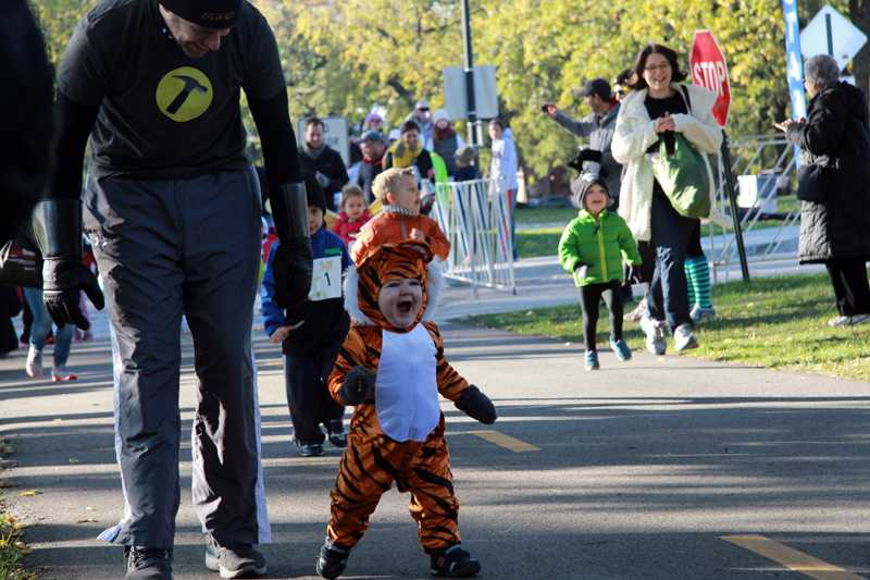 +A+Halloween-ready+child+runs+in+the+Trick+or+Treat+Trot+on+Sunday+morning.+The+race+was+held+at+Centennial+Park+and+welcomed+children+of+all+ages.%0D%0A