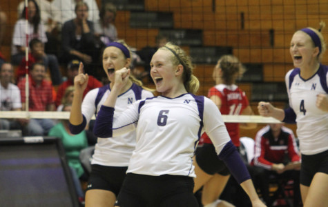 Freshman setter Caleigh Ryan celebrates with her teammates during the Wildcat Classic in September. Northwestern defeated both Indiana and Purdue in five-set thrillers on the road this weekend. Ryan received the Big Ten Freshman of the Week award for her efforts.