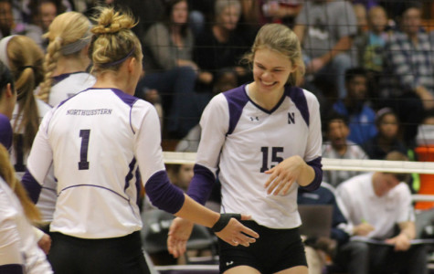 eshman Kayla Morin beams and high-fives a teammate during the Cats' match against Penn State. After a 3-0 loss to the Nittany Lions, NU hopes to bounce back at home Wednesday when they face Illinois.