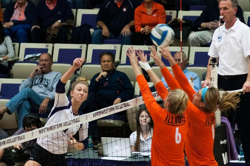 Senior+outside+hitter+Stephanie+Holthus+slams+the+ball+over+Illinois+on+Wednesday+night.+The+Wildcats+came+from+behind+to+win+three+consecutive+sets+and+seal+the+3-2+victory+over+the+Fighting+Illini+in+Welsh-Ryan+Arena.+Northwestern+zoomed+ahead+off+the+fuel+of+28+Holthus+kills.
