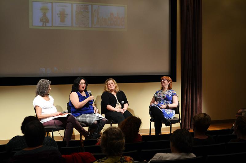 Breast cancer survivors S.L. Wisenberg, Paula Kamen, Laurie Edwards and Jenni Prokopy discuss how they use writing to build awareness about breast cancer. The panel was held at Annie May Swift Hall on Tuesday night.