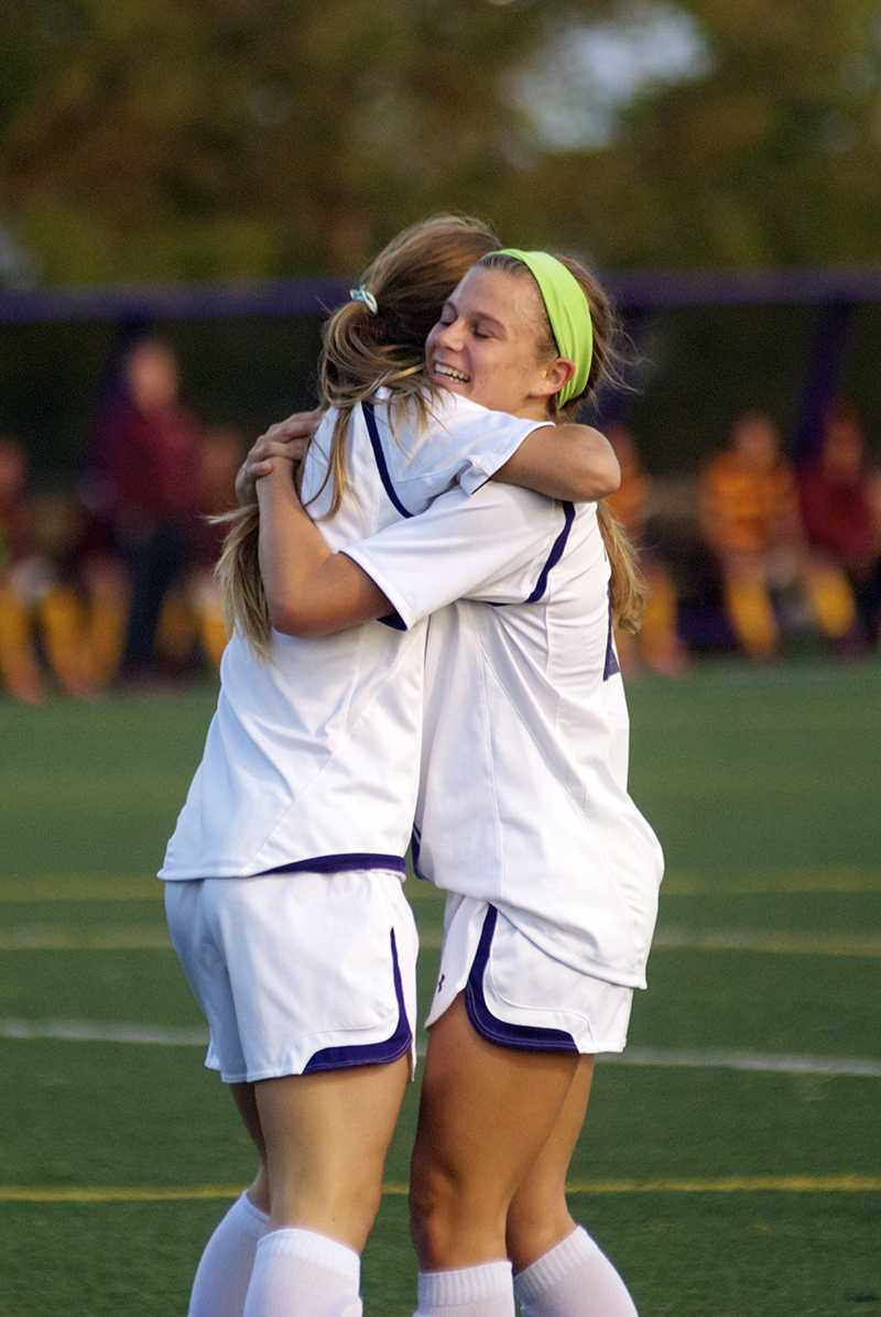 Junior forward Katie Landgrebe embraces freshman forward Addie Steiner during Saturday's match against Minnesota. Steiner scored her first career goal versus the Golden Gophers. Northwestern hopes to sustain its joy and earn another victory as  Big Ten play continues Thursday.
