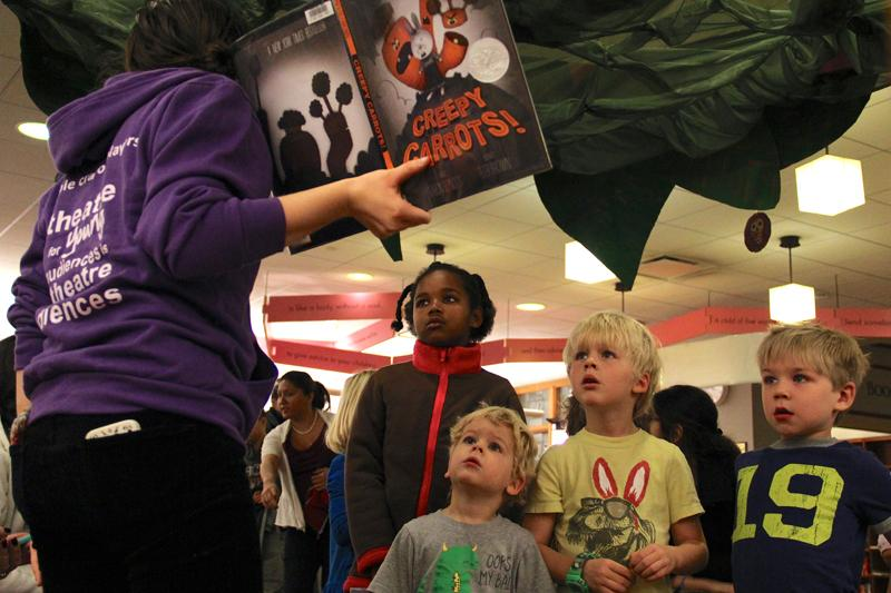 Children+listen+to+a+dramatic+reading+of+a+scary+story+at+the+Day+of+the+Dead+celebration+at+Evanston+Public+Library+on+Saturday+afternoon.%0A