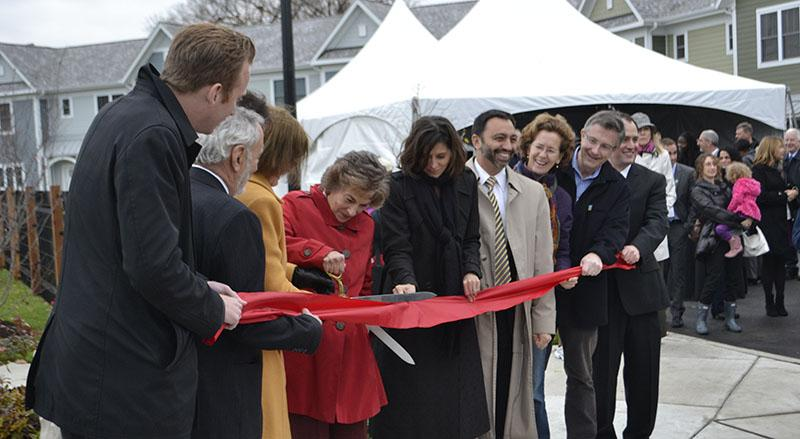 Rep. Jan Schakowsky (D-Evanston) and other city, state and federal officials cut the ribbon in front of Emerson Square Apartments. More than 50 people gathered for the official opening of the new affordable housing complexes.