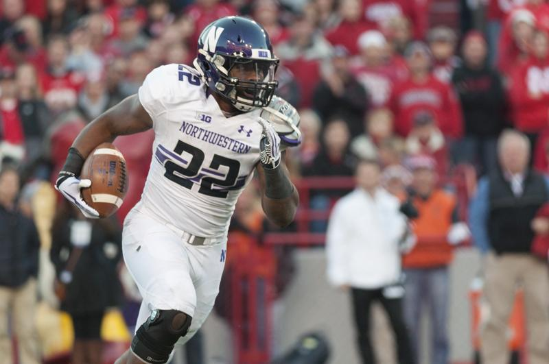 Running back Treyvon Green sprints downfield Saturday in Northwestern's crushing 27-24 loss to Nebraska. The junior performed spectacularly, scoring all three of the Wildcats' touchdowns and finishing with 149 yards.