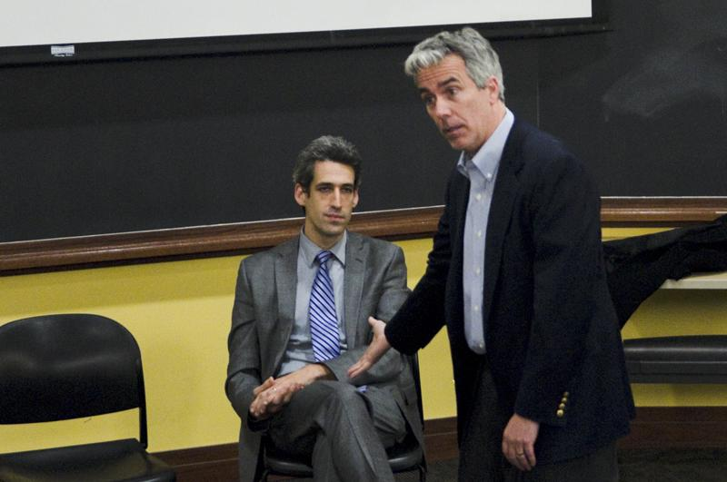 State Sen. Daniel Biss (D-Evanston) listens as former U.S. Rep Joe Walsh (R-Ill.) opens discussion on freedom at the bipartisan forum hosted by College Republicans on Tuesday evening. The event was co-sponsored by College Democrats.