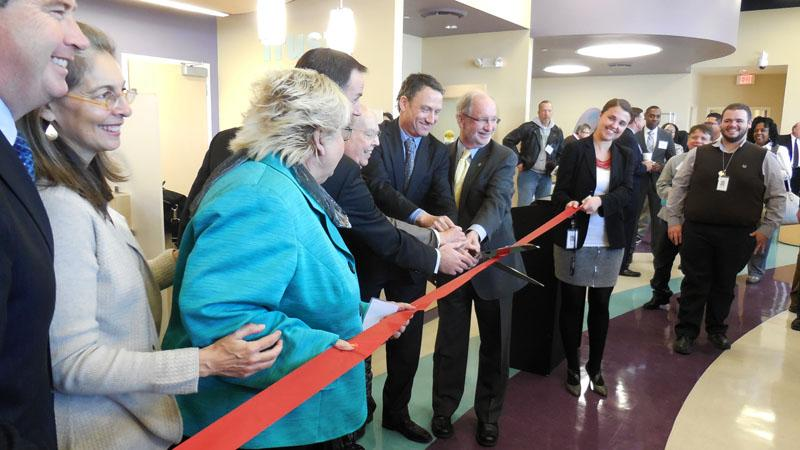 Erie Family Health board members gather to cut the ribbon at the new, permanent location of its Evanston health center. Evanston and Skokie mayors gave their remarks, and staff-led tours of the facility followed.