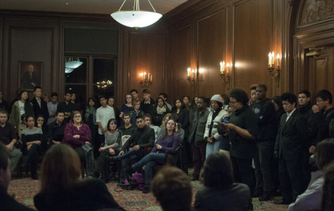 Friends and classmates listen Thursday night as speakers memorialize the life of former Northwestern student Alexis Lasker, who committed suicide Saturday. The intimate gathering, organized by her close friends, drew more than 100 attendees in Harris Hall.