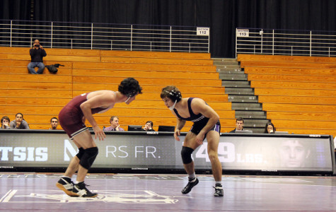 Redshirt freshman Jason Tsirtsis faces off against his Chicago adversary in Northwestern's first match of the season. Coach Drew Pariano has high expectations for the four-time high school state champion.