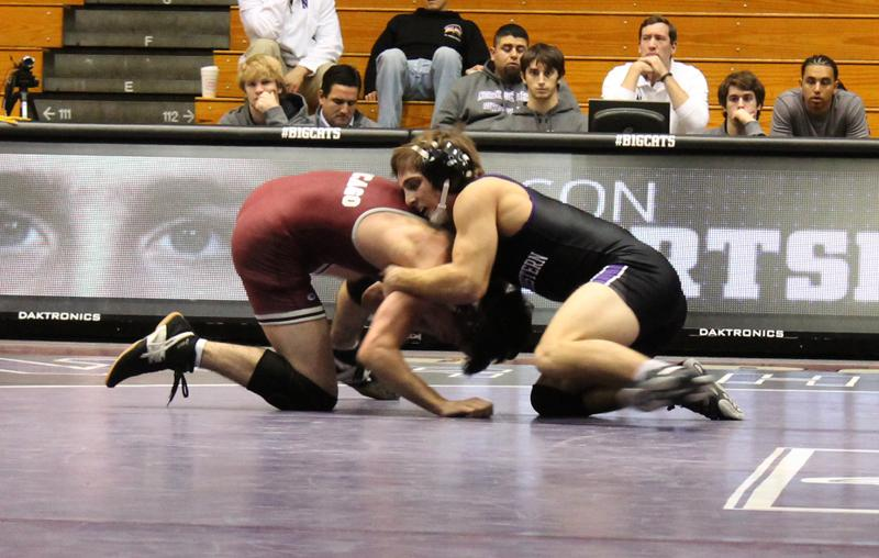 Redshirt freshman Jason Tsirtsis grapples with his Chicago opponent during Northwestern's opening weekend. Tsirtsis was the only member of the Wildcat squad to claim his weight class' title in the Keystone Classic last weekend.