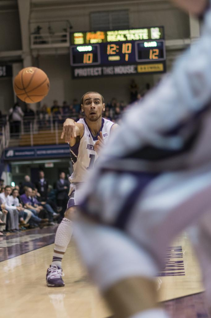 Sophomore guard Tre Demps looks for a teammate early in Saturdays game against Iowa. NU stayed close in the first half before being outscored handily after halftime.