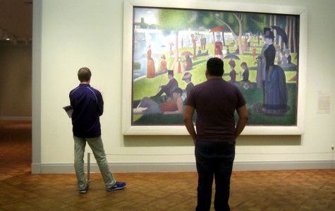 Guests at the Art Institute of Chicago observe Georges Seurat's