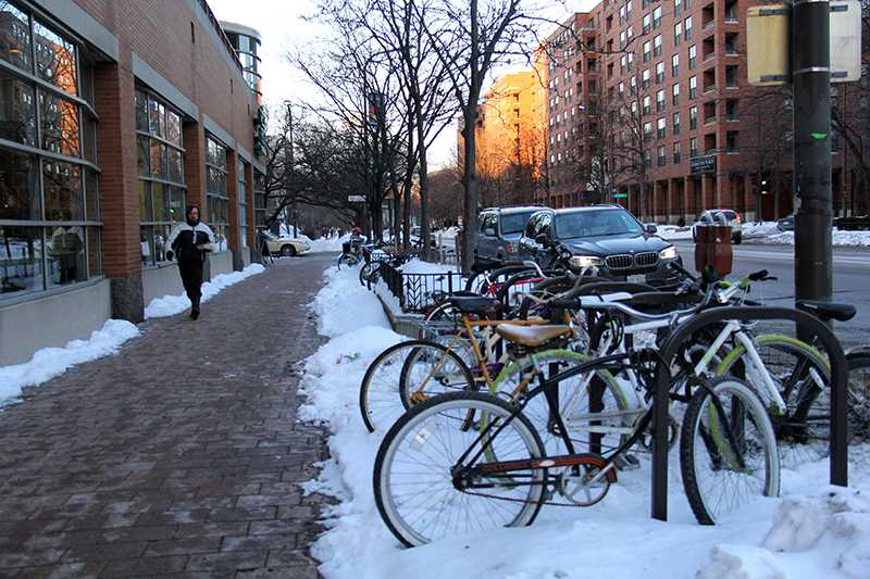 Bikes sit parked outside of Whole Foods, 1640 Chicago Ave. Despite the recent drop in temperatures, outdoor racks remain popular places to store bikes because free storage in campus buildings is limited.