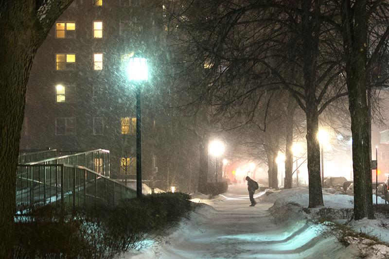 A+student+walks+home+in+the+snow+on+a+Sunday+night+in+2014.+Northwestern+will+be+closed+again+this+week+from+Tuesday+to+Thursday.+