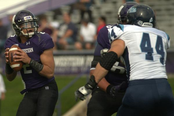Senior quarterback Kain Colter displayed APU, short for All Players United on his wristbands during a September game against Maine. Colter is leading the movement to attempt to get Northwestern football players represented by a union.