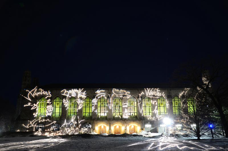"""Italian artist Marco Rotelli illuminated Deering Library this week. The light show was based on a quote from a Dylan Thomas poem, """"Rage, Rage Against the Dying of the Light."""""""