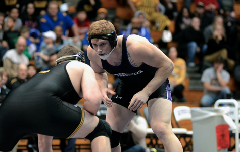 Wrestling: Northwestern falls to top-ranked Iowa, McMullan poised to move up in standings after second No. 1 takedown