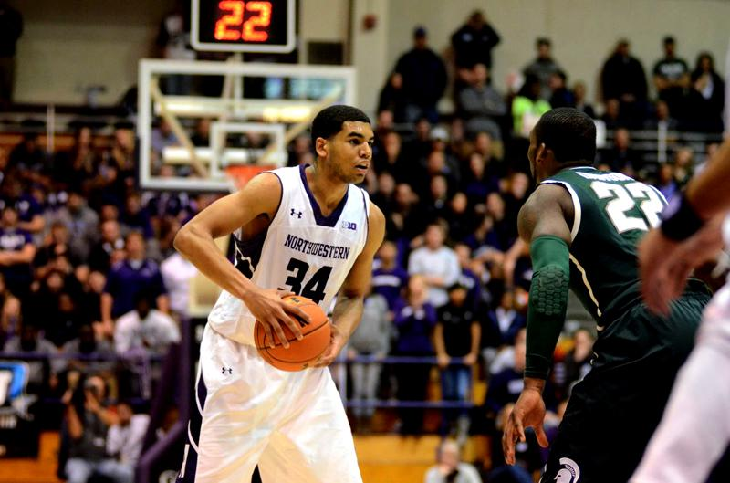"""Redshirt freshman Sanjay Lumpkin looks to get a pass off. Lumpkin's impressive defense against Michigan State on Wednesday night exemplified what coach Chris Collins calls the team's """"blue collar, defensive"""" style."""