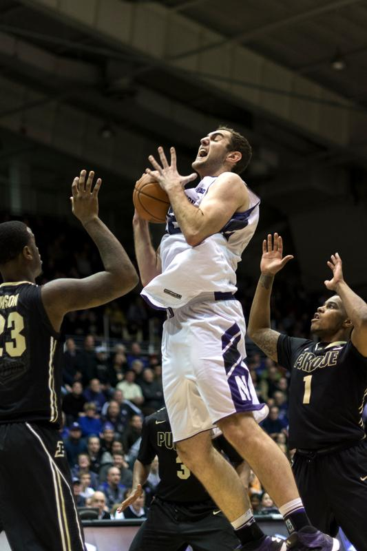 Sophomore center Alex Olah, pictured snagging a rebound in Tuesday's win against Purdue, has been an important cog in Collins' new defensive machine. Olah averages more than five rebounds per game and leads the team in blocks with 38 so far this season.